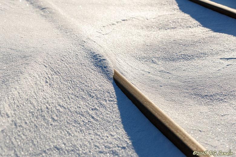 Spåren göms i snön